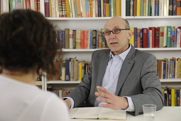 a legal consultant conversing with a client